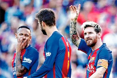 Lionel Messi scores on return; Atletico Madrid, Real Madrid stay on top