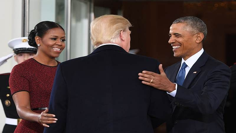 Donald Trump (C) is greeted byBarack Obama and Michelle Obama (L) as he arrives at the White House in Washington, DC