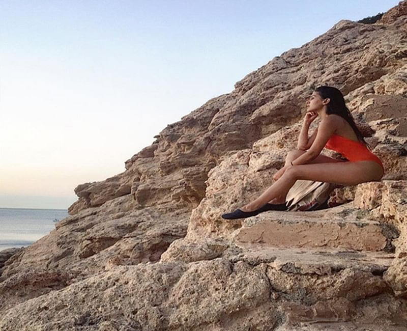 Hotness Alert: Amyra Dastur is a sultry siren in this orange swimsuit