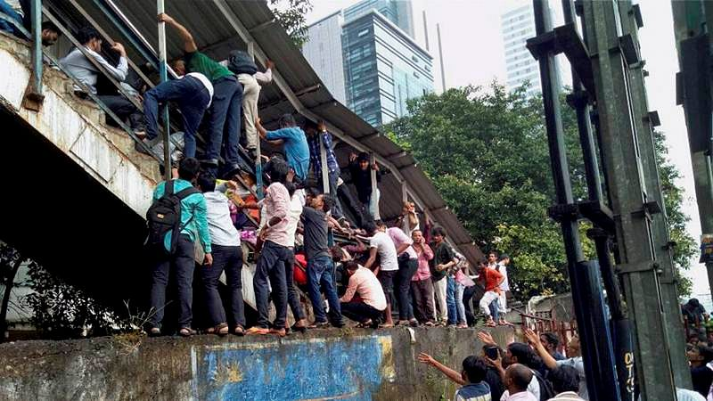 Mumbai: 22 dead as they are caught in rush hour stampede on narrow Elphinstone overbridge