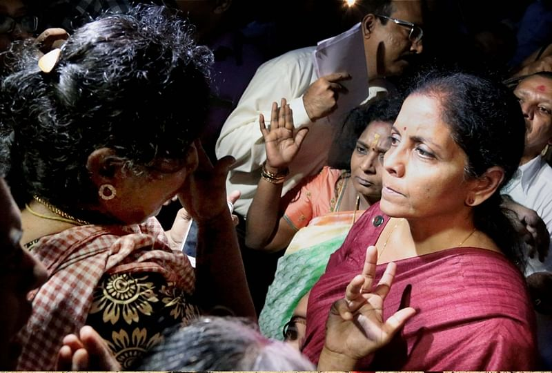 Kanyakumari: Union Minister for Defence, Nirmala Sitharaman meeting with the people affected by Cyclone Ockhi in the flood-hit Kanyakumari district on Sunday. PTI Photo  (PTI12_3_2017_000188B)