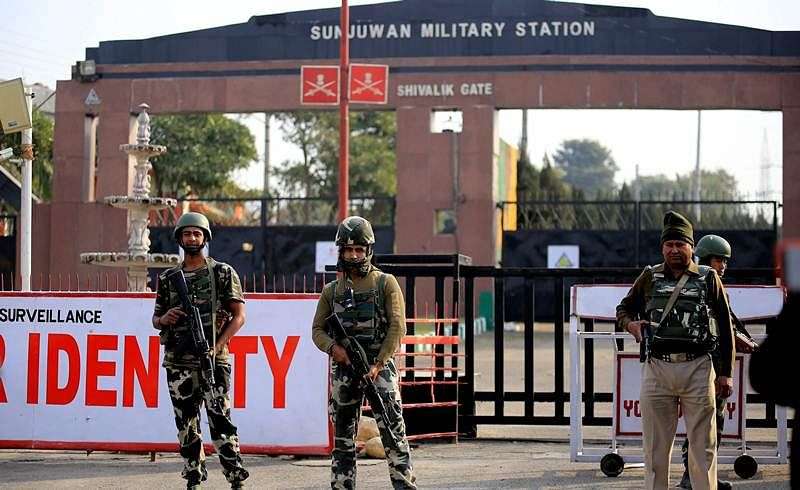 Security personnel takes positions during a militants attack Sunjuwan Army camp. PTI Photo
