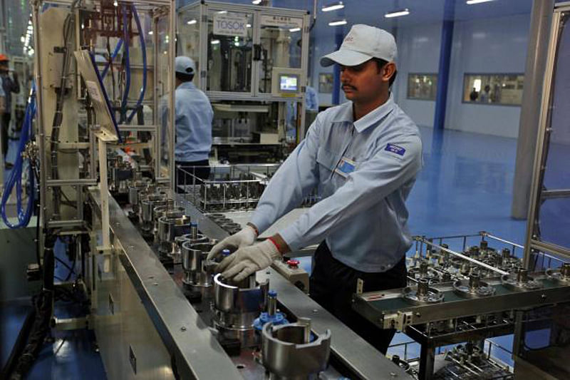 Factory activity growth hits slow pace in December
