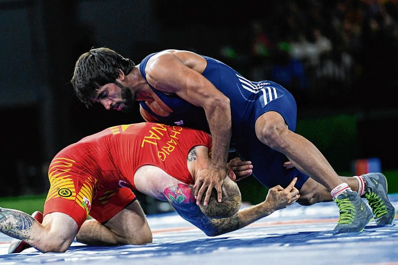 India's Bajrang (R) wrestles with Wales' Kane Charig during the men's freestyle 65 kg gold medal wrestling match at the 2018 Gold Coast Commonwealth Games in the Carrara Sports Arena on the Gold Coast on April 13, 2018. / AFP PHOTO / YE AUNG THU