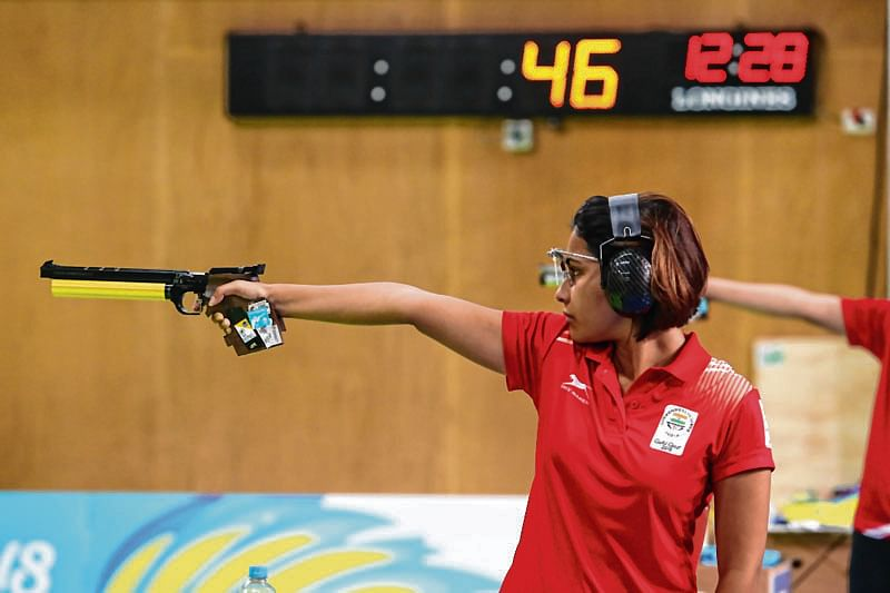 India's Manu Bhaker competes during the women's 10m air pistol competition at the 2018 Gold Coast Commonwealth Games at the Belmont Shooting Complex in Brisbane on April 8, 2018. / AFP PHOTO / Patrick HAMILTON