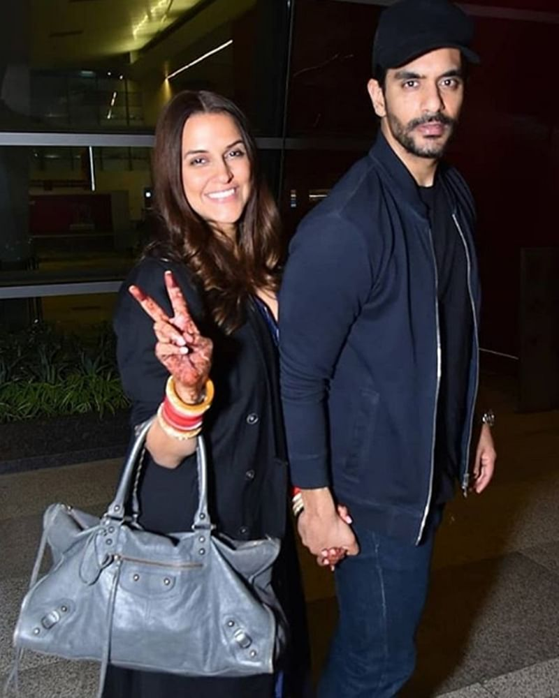 Newly-weds Neha Dhupia and Angad Bedi leave for honeymoon; see pics