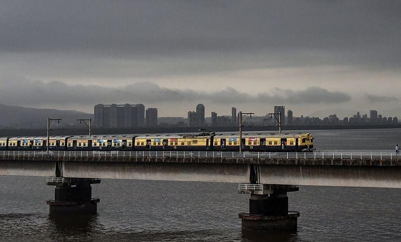 Mumbai Rains: Heavy rain lash Mumbai, trains on all lines running late