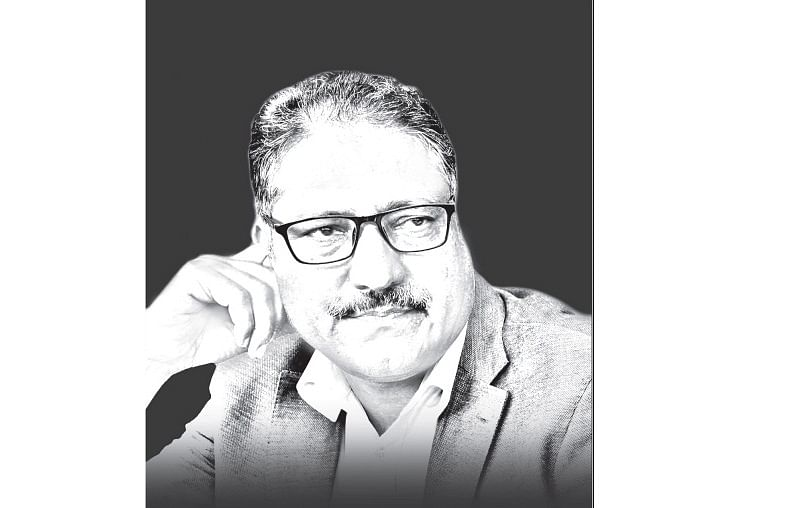 Day after losing Shujaat Bukhari, Rising Kashmir hits stands with slain editor's picture in black background