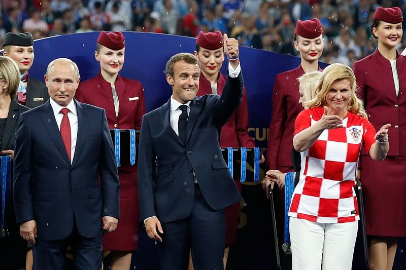 Russian President Vladimir Putin, French President Emmanuel Macron and Croatian President Kolinda Grabar-Kitarovic during the medals ceremony after the Russia 2018 World Cup final football match between France and Croatia at the Luzhniki Stadium in Moscow on July 15, 2018. / AFP PHOTO / Odd ANDERSEN / RESTRICTED TO EDITORIAL USE - NO MOBILE PUSH ALERTS/DOWNLOADS