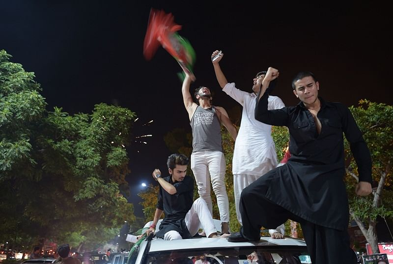 Pakistan elections 2018: PTI workers sense victory, celebrate on streets in Pakistan
