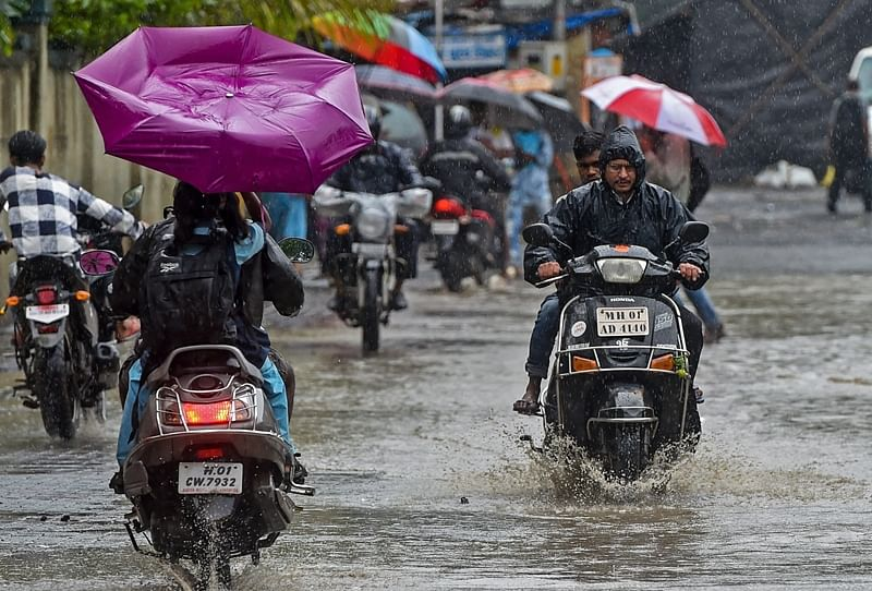 Mumbai Rains Pictures: Normal life disrupted, rail, road traffic affected, maximum city crawls