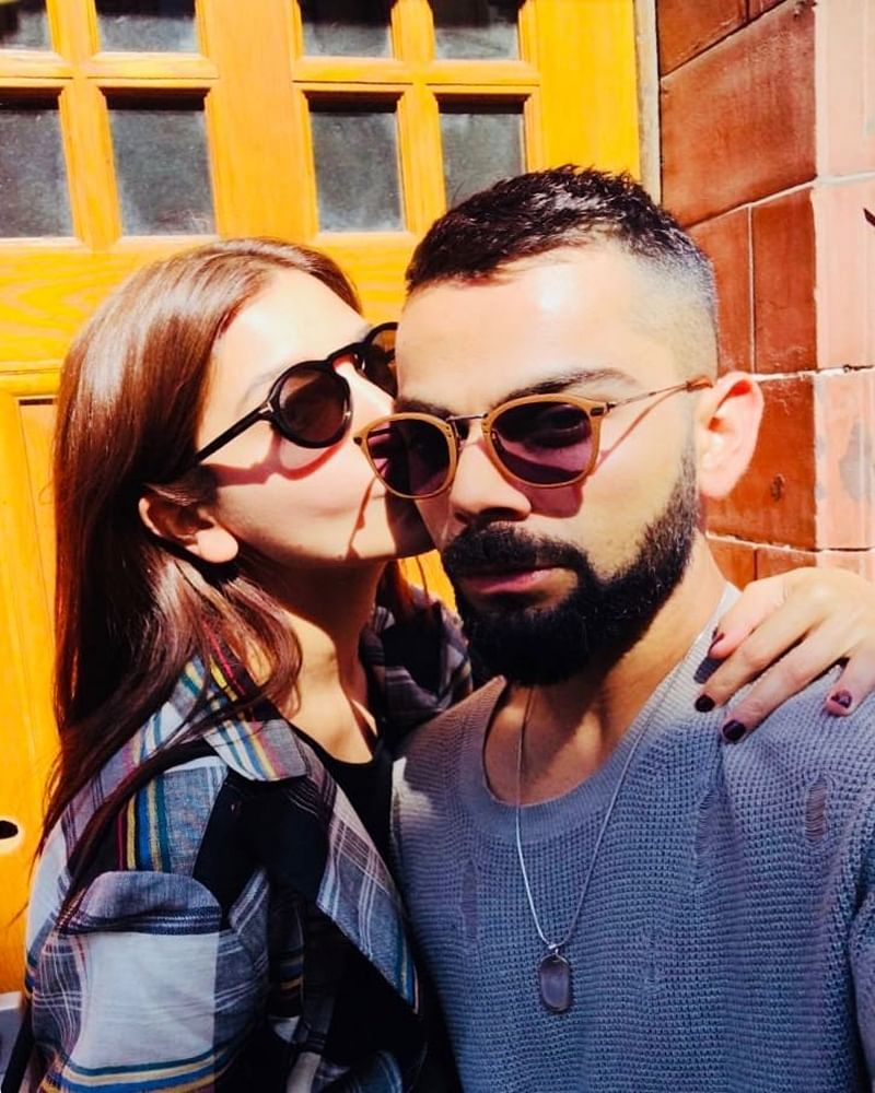 Anushka Sharma gives Virat Kohli 'Kiss of Love', Indian skipper shares pic of day out with 'beauty'