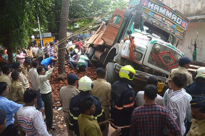 Mumbai: Truck gets stuck in manhole, overturns
