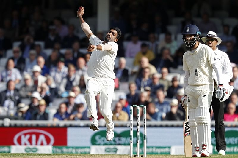 India's Jasprit Bumrah bowls during play on the first day of the fifth Test cricket match between England and India at The Oval in London on September 7, 2018. (Photo by Adrian DENNIS / AFP) /