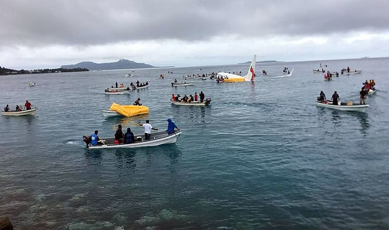 Air Niugini now says 1 missing after plane crash in Pacific lagoon