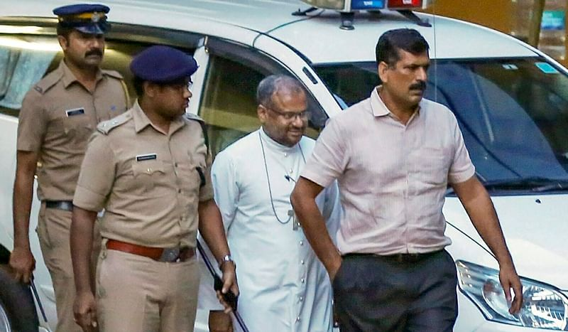 File photo of rape accused Bishop Franco Mulakka leaves after a questioning by the SIT. PTI Photo