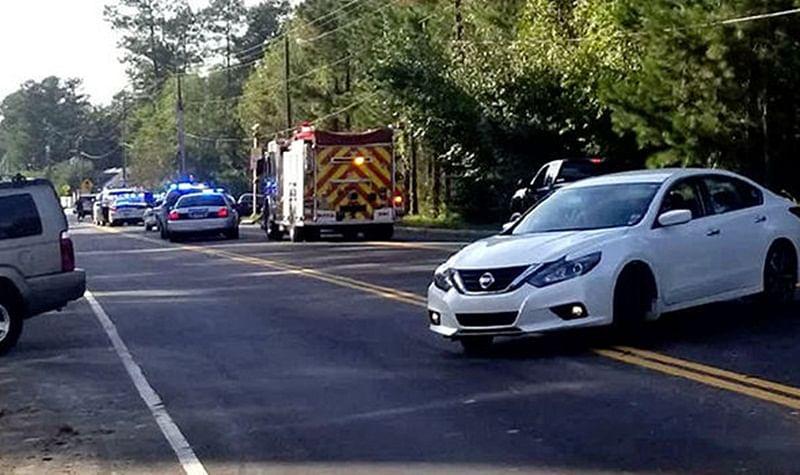 US Shooting: Suspect in custody after policeman shot dead