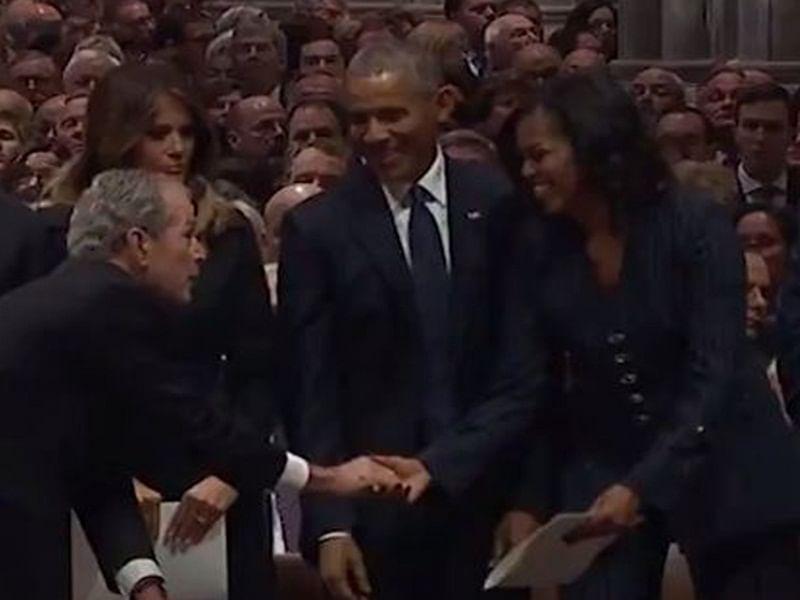Did George W. Bush slip candy to Michelle Obama again?