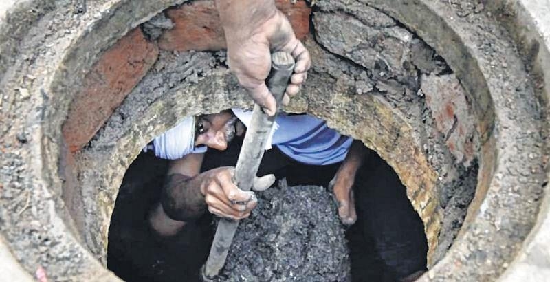 Three killed in toxic manhole