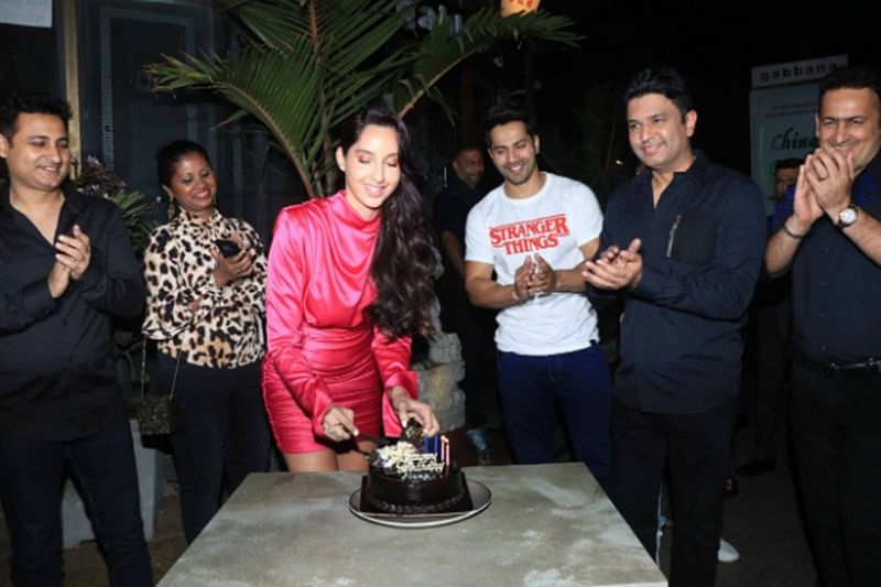 In pictures! 'Dilbar' girl Nora Fatehi rings her birthday with Street Dancer 3D duo Varun Dhawan and Bhushan Kumar