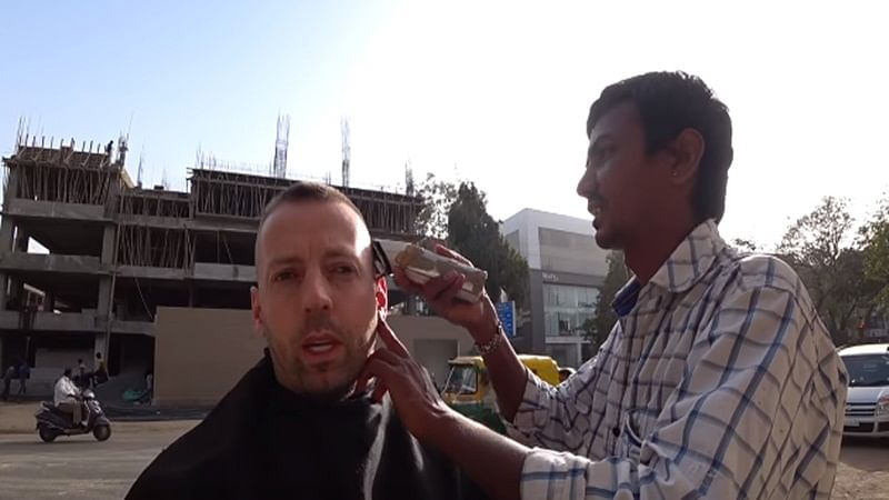 The Royal Haircut! YouTuber pays Rs 30,000 for Rs 20 haircut to roadside barber in India, watch video