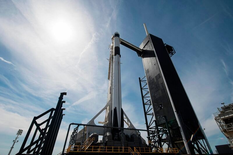 """This handout photo released  NASA shows a SpaceX Falcon 9 rocket with the company's Crew Dragon spacecraft onboard is seen seen on the launch pad at Launch Complex 39A  as preparations continue for the Demo-1 mission on March 1, 2019 at the Kennedy Space Center in Florida. - The Demo-1 mission will be the first launch of a commercially built and operated American spacecraft and space system designed for humans as part of NASA's Commercial Crew Program. The mission, currently targeted for a 2:49am launch on March 2, will serve as an end-to-end test of the system's capabilities. (Photo by Joel KOWSKY / NASA / AFP) / -----EDITORS NOTE --- RESTRICTED TO EDITORIAL USE - MANDATORY CREDIT """"AFP PHOTO / NASA / JOEL KOWSKY """" - NO MARKETING - NO ADVERTISING CAMPAIGNS - DISTRIBUTED AS A SERVICE TO CLIENTS"""
