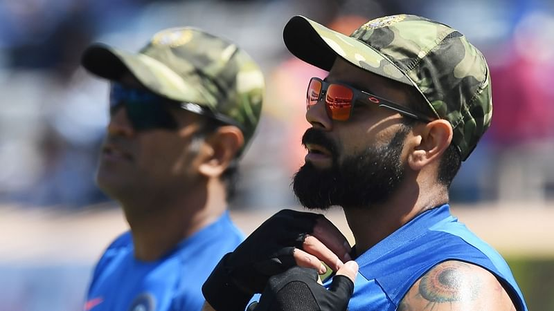 Indian cricket captain Virat Kohli and Mahendra Singh Dhoni (R) wear camouflage army caps ahead of the third one-day international (ODI) cricket match between India and Australia at the Jharkhand State Cricket Association International Cricket Stadium in Ranchi on March 8, 2019, as the Indian cricket team wore the caps as a gesture towards the Indian Armed Forces following tensions with Pakistan in recent weeks in the wake of a suicide attack on a convoy in Kashmir. (Photo by DIBYANGSHU SARKAR / AFP) / ----IMAGE RESTRICTED TO EDITORIAL USE - STRICTLY NO COMMERCIAL USE-----