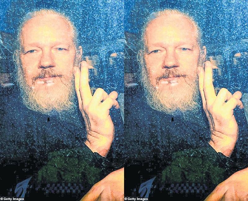 Julian Assange hustled out of embassy hideout