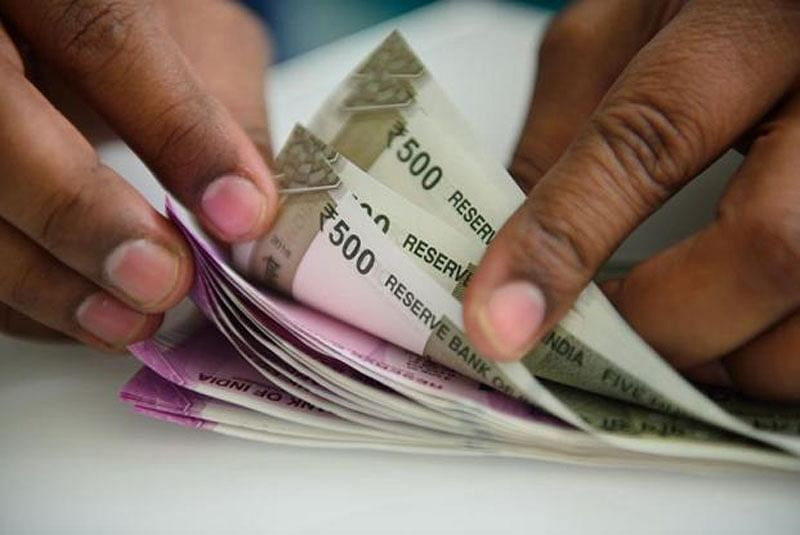 Rupee slips 24 paise to 69.46 against USD in early trade