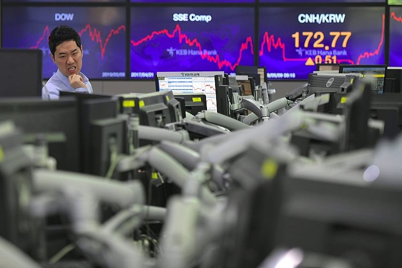 Most Asian markets up but traders on edge as tariffs are hiked